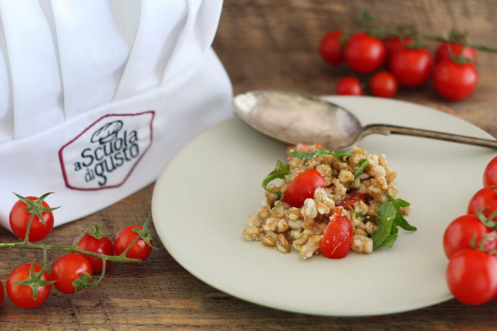 Spelt salad with cherry tomato, arugula, Parmesan and balsamic vinegar.