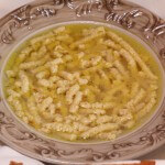 Passatelli romagnoli in brodo/ Passatelli in brodo, typical first course from Romagna.