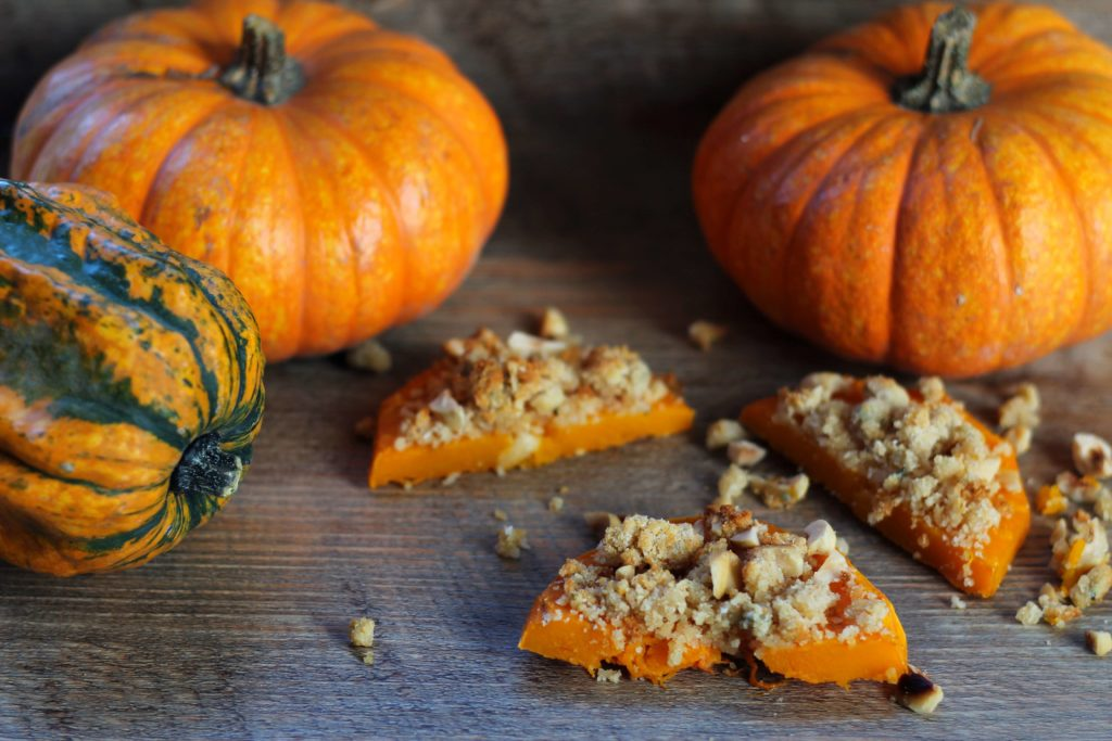 Baked pumpking with blue cheese, rosemary and hazelnut crumble.